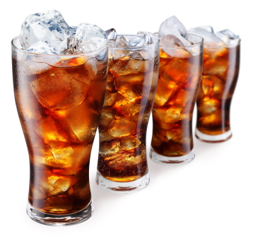 Glasses with cola and ice cubes on a white background